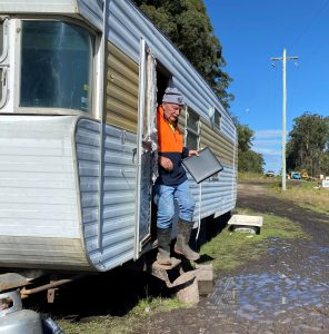John stepping out of his new project, his caravan.